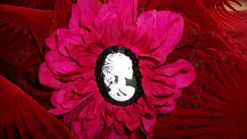 Lush pink flower with a Day of the Dead cameo centre, decorated with glittery black sequin trim. $15
