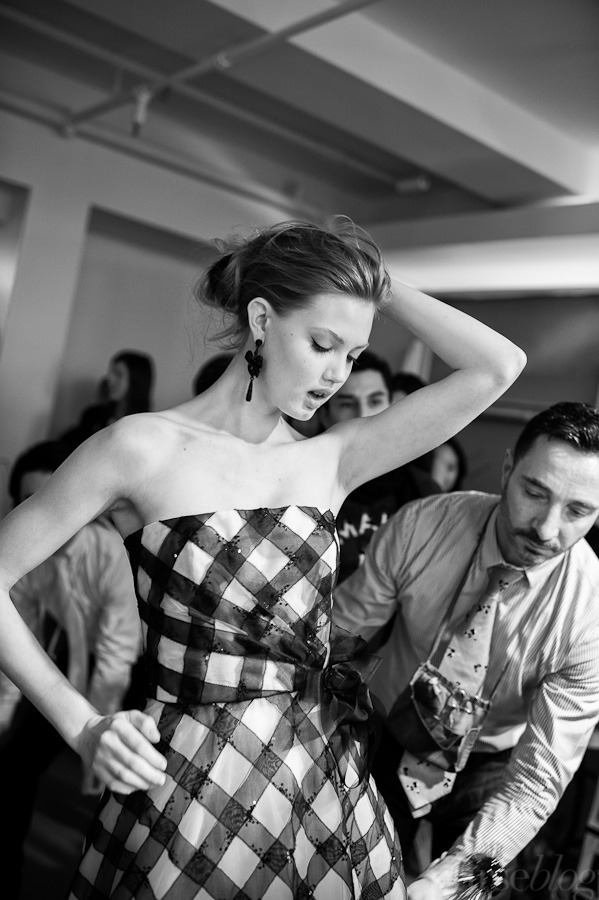 Lindsey looks fierce while Raffaele works his magic touch.