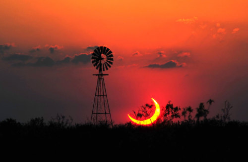 n-a-s-a:  A Partial Solar Eclipse over Texas  Image Credit & Copyright: Jimmy Westlake (Colorado Mountain College) & Linda Westlake