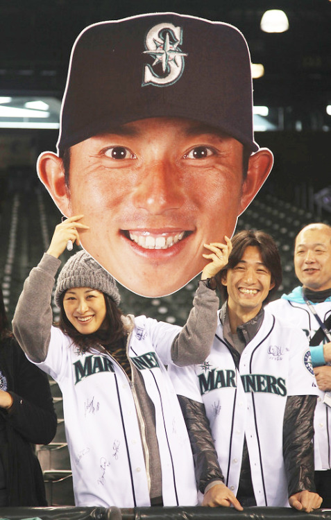 fuckyeahbaseball:   SEATTLE, WA - MAY 21: Fans hold a giant cutout of Munenori Kawasaki of the Seattle Mariners prior to the game against the Texas Rangers at Safeco Field on May 21, 2012 in Seattle, Washington. (Photo by Otto Greule Jr/Getty Images)  Favorite photo of the season so far.