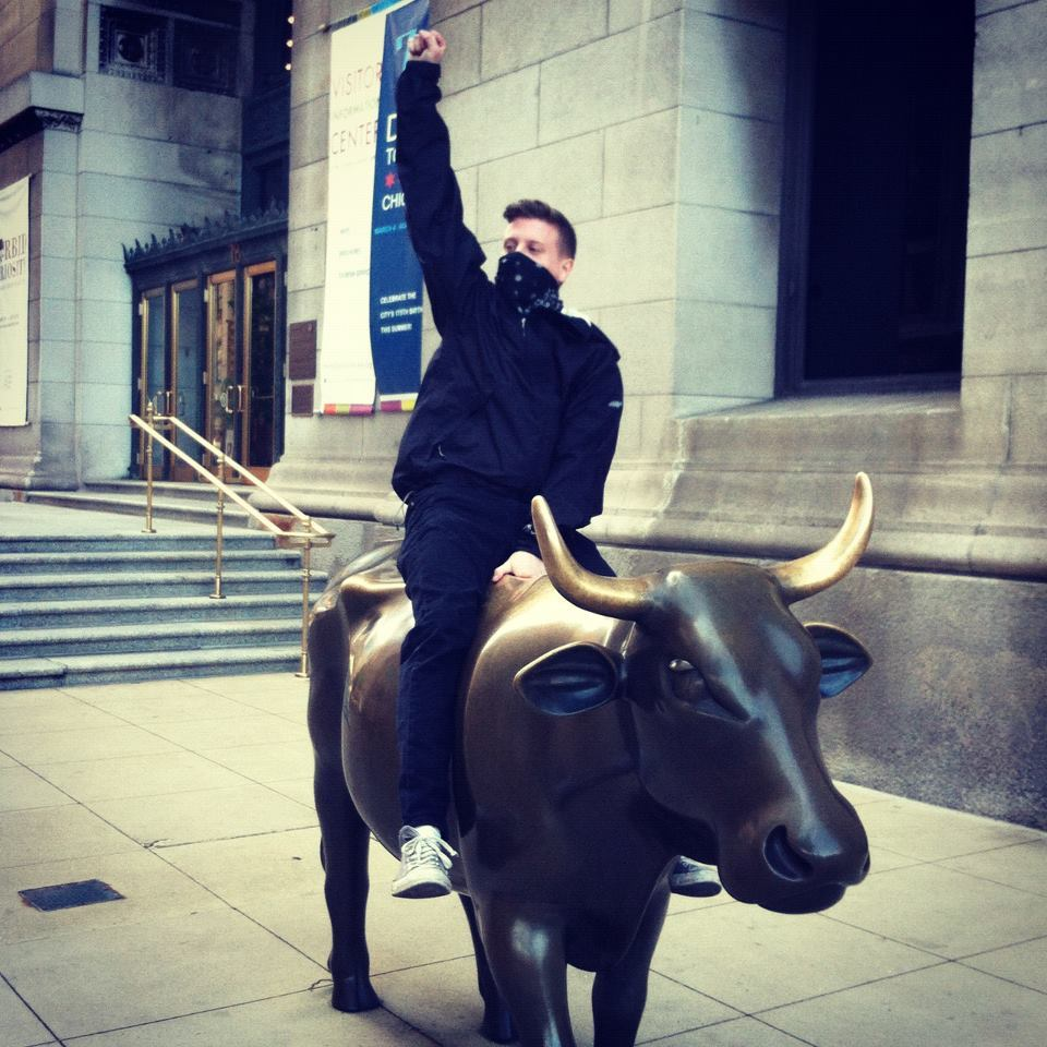 Riding a cow statue in Chicago during the NATO summit. It looked so similar to the wall st bull. I couldn't resist.