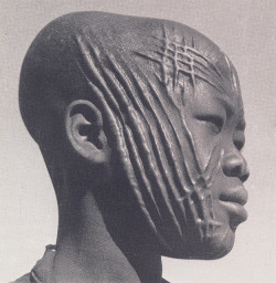 "anachoretique:  boy from Chad scanned from ""The Decorated Body"""