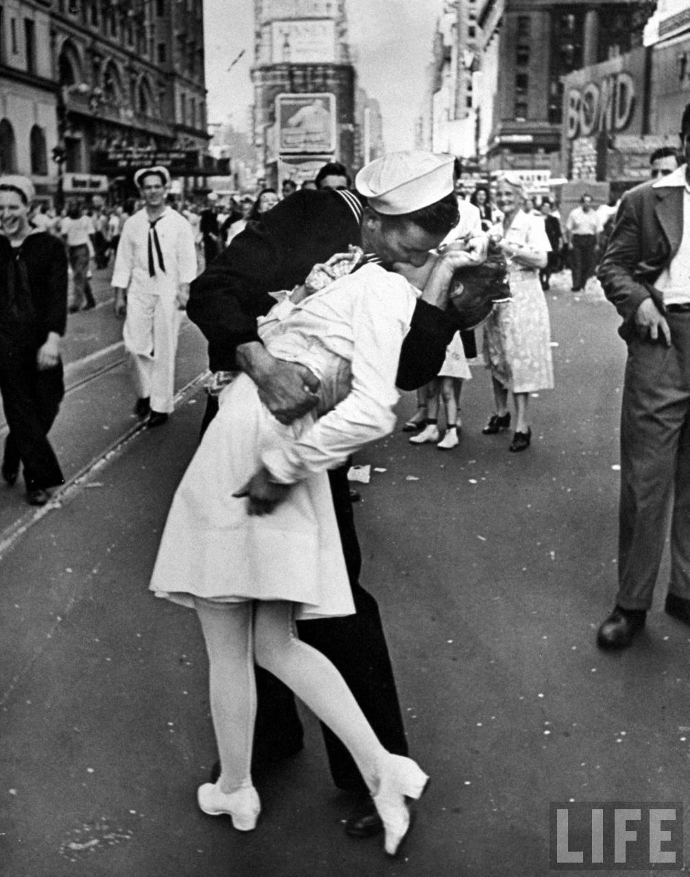"Alfred Eisenstaedt: A jubilant American sailor clutching a white-uniformed nurse in a back-bending, passionate kiss as he vents his joy while thousands jam Times Square to celebrate the long awaited-victory over Japan, New York, 1945.   ""In Times Square on V.J. Day, I saw a sailor running along the street grabbing every girl in sight. I was running ahead of him with my Leica looking back over my shoulder. Then suddenly, in a flash, I saw something white being grabbed. I turned around and clicked the moment the sailor kissed the nurse…I took exactly four pictures. It was done within a few seconds.""   This is the most famous picture that Alfred Eisenstaedt ever took. This image has been reproduced countless times and resulted from Eisie's instinct for what would make a good photograph. He recounted that he had followed the sailor who was ""running along the street grabbing any and every girl in sight. Whether she was a grandmother, stout, thin, old, didn't make any difference."" The picture, that of a sailor in his blue uniform kissing a nurse in her white uniform, with a passion usually reserved for lovers, became synonymous with the mood of celebration the country felt at the war's end. Even those who did not know his name, knew his picture. Eisenstaedt was almost 47-years-old when he took that picture. He got it as he got many of his pictures-persistence rather than planning. He often noted that he had learned it was the reaction to an event that created the best picture, rather than the event itself. That day in August of 1945, Eisenstaedt was simply walking among the crowd that had gathered on the streets of New York. One of the people he noticed was a sailor who was kissing his way through the crowd. He followed him long enough to see him grab the woman whose outfit in white brought the contrast of the sailor's blue to his keen eye. At that moment, Eisenstaedt snapped the picture. ""I will be remembered when I'm in heaven. People won't remember my name, but they will know the photographer who did that picture of that nurse being kissed by the sailor at the end of World War II. Everybody remembers that."" For many years, the identities of the sailor and the nurse in the famous picture remained unknown. But in 1980, a woman named Edith Shain stepped forward and said she was the nurse in the photo. In interviews she has claimed that many sailors were out kissing everyone that day because they were happy to be home and would not be going back to war. It took a bit longer for the sailor to be identified. Glenn McDuffie said in 2007 that he was the sailor in the picture. According to McDuffie, he was exiting the subway in New York when a lady expressed how happy she was for him on account of the end of the war. He ran out into the street cheering and hollering, and then grabbed the nurse and kissed her. It is impossible to prove or disprove absolutely the claims of McDuffie and Shain, and Time has said that the reason why the photo has remained so iconic is because it represents everyman."