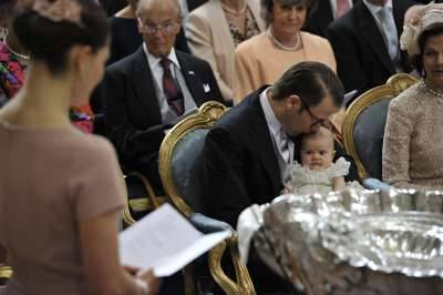 Prince Daniel kisses his daughter, Princess Estelle, during her christening.