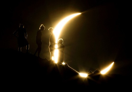 "This has to be one of the best eclipse photos I've seen recently. ""Eclipse watchers at Papago Park in Phoenix, Arizona are silhouetted against the eclipsed sun"" by Michael Chow (Arizona Republic 