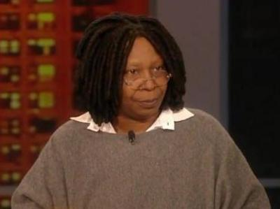 Whoopi Goldberg always looks like she's heading to a beginner's painting class.