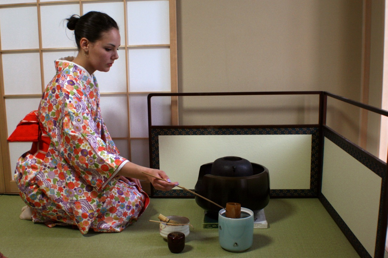 "Bean refreshing the kettle at her Japanese Tea Ceremony Class (May 22nd, 2012). Today we attended Bean's Tea Ceremony class. We wore kimonos thanks to Nikami-Sensei and her sister. They GAVE me the beautiful green one which I wore - I was so honored. I really mean that even though it's impossible to sound sincere on tumblr. Pics are forthcoming and video - Bean did great today; the tea was delicious and frothy!  ""MY MATCHA BRINGS ALL THE BOYS TO THE YARD"" - Bean"