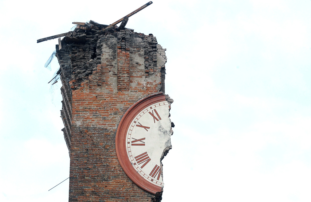 From Earthquake in Northern Italy, one of 30 photos. Half of a clock face on Modenesi's Towers of Finale Emilia, destroyed following an earthquake on May 20, 2012 in Ferrara, Italy. (Roberto Serra/Iguana Press/Getty Images)