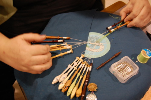 A member of Sir Walter's Lacers demonstrates bobbin lacemaking