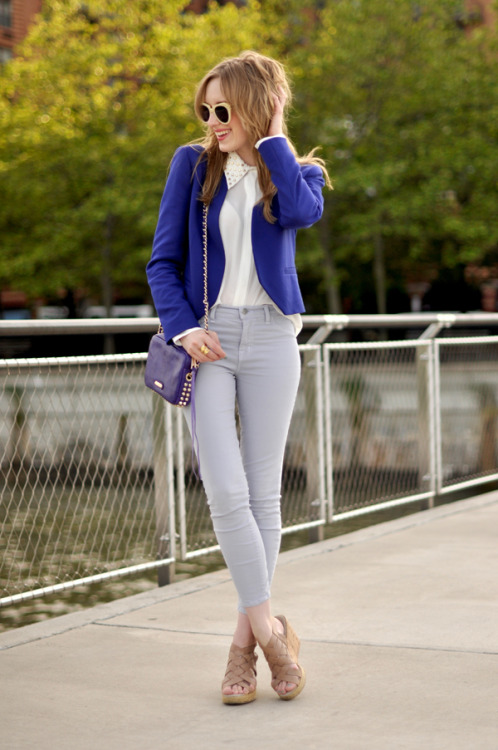Kim of Eat Sleep Wear matches a blue blazer with her studded bag.