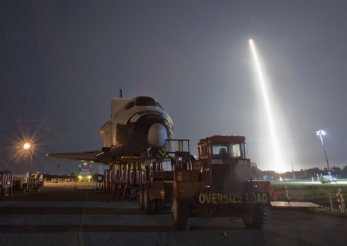 OUT WITH THE OLD…    The SpaceX Falcon 9 test rocket lifts off from Space Launch Complex 40 at the Cape Canaveral Air Force Station in Cape Canaveral, Florida, on Tuesday.  The unmanned rocket, built by billionaire entrepreneur Elon Musk's SpaceX venture, is the first non-governmental spacecraft to launch to the space station, ushering in a new era of partnership between the public and private spaceflight programs.  A mock space shuttle, the Explorer, is seen below, on the grounds of Kennedy Space Center; it had been moved to make room for the retired shuttle Atlantis.  (Photo: Michael R. Brown / Reuters via MSNBC)
