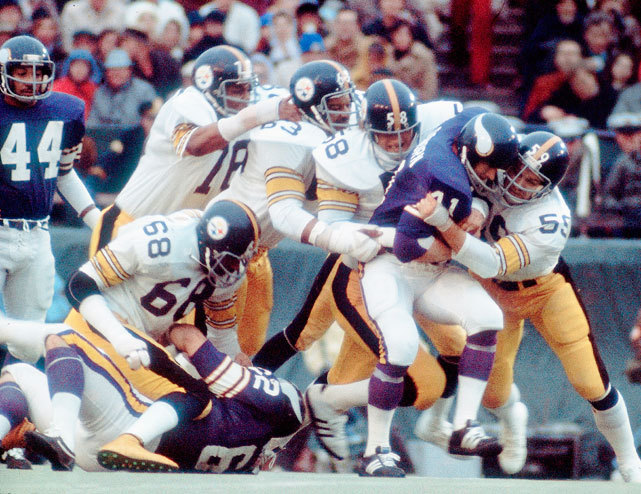 "Jack Ham (59), Jack Lambert (58), Ernie Holmes (63) and Dwight White (78) gang tackle Dave Osborn during Super Bowl IX between the Steelers and Vikings. The ""Steel Curtain Defense"" held the Vikings to 6 points as Pittsburgh rolled to a 16-6 victory. (Walter Iooss Jr./SI) GALLERY: Classic Photos of the Pittsburgh Steelers"