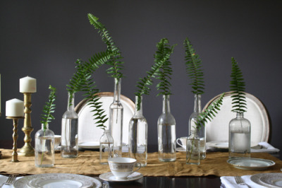 Empty bottles + fern fronds = simple, gorgeous tablescapes Yes, this is a no-brainer example of reuse, but the photo, via Design*Sponge, is just so good, I'm posting it! Also: It's wine o'clock somewhere, so there's that to add for justification for sharing. P.S. about wine o'clock: As always, find Unconsumption's special collection of wine-related repurposing posts here.