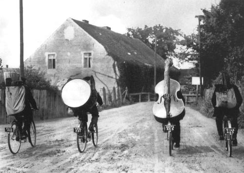 firsttimeuser:  Folk musicians touring the European countryside by bicycle photo by Roger Viollet