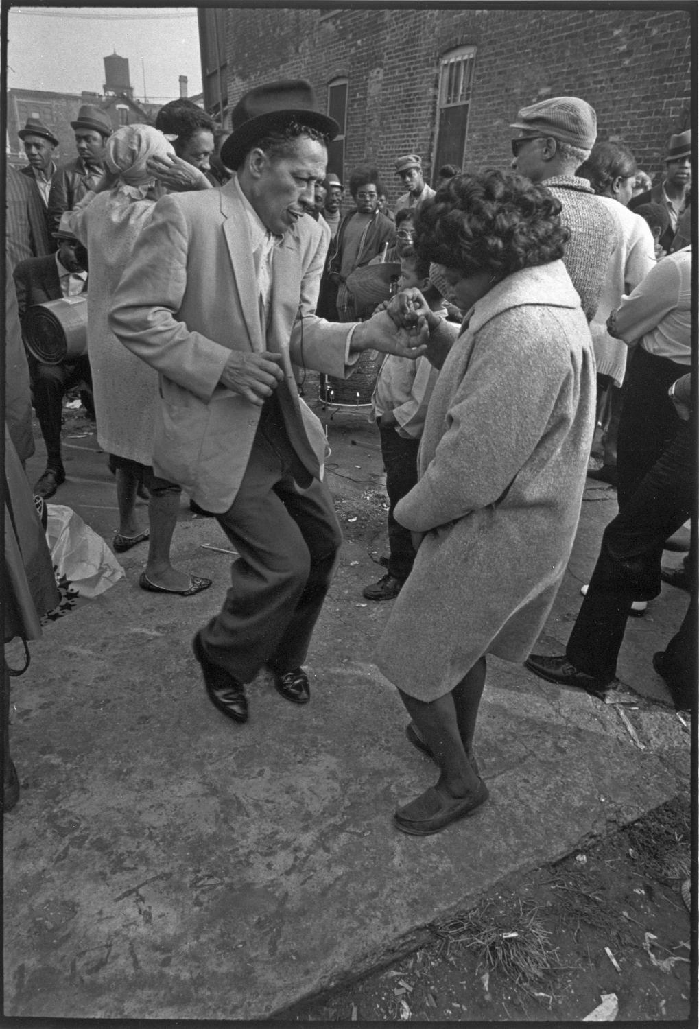 chicagohistorymuseum:  People dancing near Peoria St. between Maxwell St. and 14th St. Undated photograph by James Newberry.  Want a copy of this photo? > Visit our Rights and Reproduction Department and give them this number: ICHi-35008.