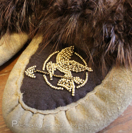 DIY Gold Beaded Mockingjay Moccasin Restyle Tutorial. I saw these yesterday on One Artsy Mama's Round One of a Beading Contest but the bloggers names were kept secret. So I was happy to find the tutorial today on Practically Functional's site here. *You could of course do this on so many other things besides moccasins. EDIT: This entry lost - I can't believe it! It was the only thing I posted out of all the entries!