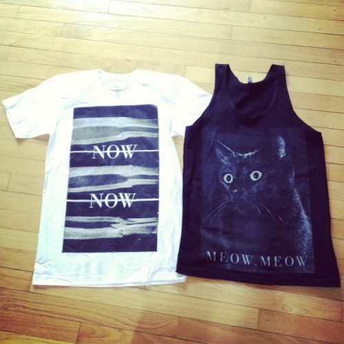 okaycaceface:  nownowband:  Look what we have! Two new designs that we're taking on tour this summer. Meow. (Taken with instagram)  Cha ching.  Omg meow, meow!