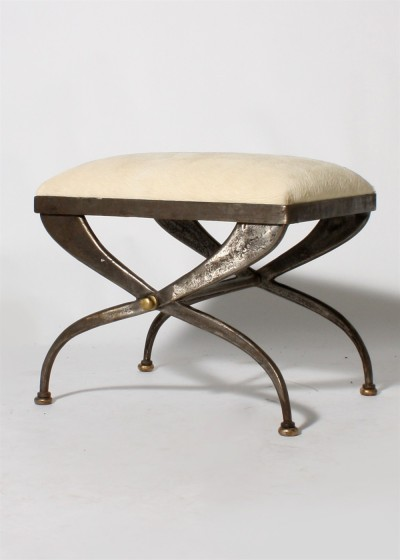 1940. Iron Bench with Ivory Cowhide Upholstery. A more modern take on a Greek Diphros x-based stool. I like the patina/luster of the iron paired with the warm accents of metal to highlight the stretcher and the feet.