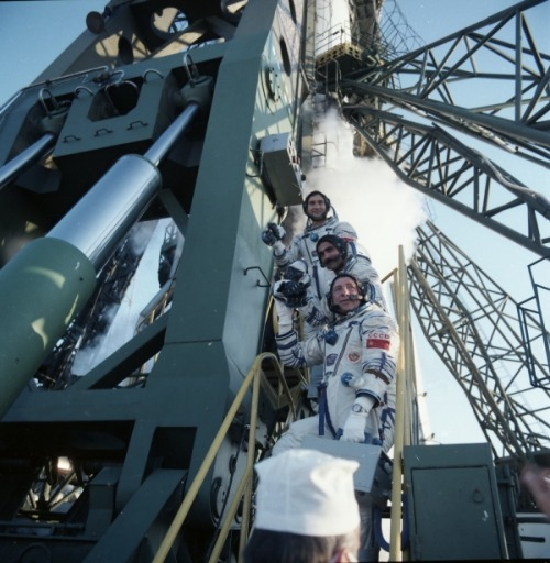 The crew of Soyuz TM-6 before launch: Valeri Polyakov, Abdul Ahad Mohmand (Afghanistan) and Vladimir Lyakhov. Mohmand became the fourth Muslim in space. (1988) (Source)