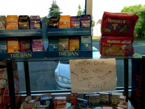 "Sign Offers Choice Between Condoms and Diapers ""Can you figure out some way to get the condoms to sell better?"""
