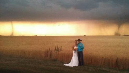 (via Tornadoes Become Unexpected Wedding Guests - weather.com) Will this be the new trend in wedding/engagement photos?