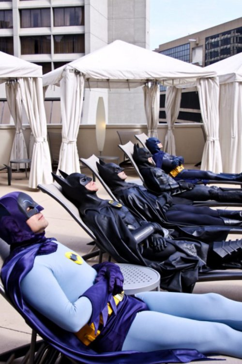 collegehumor:  Five Generations of Batman Relaxing in the Sun A sunny day for a dark knight.   Ahhhh haha