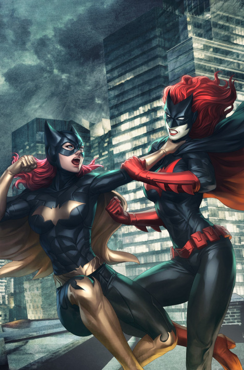 "BATGIRL vs. BATWOMAN on the cover of BATGIRL #12 by Stanley ""Artgerm"" Lau on DeviantArt. Check the detail on Batgirl's boots BTW, at her knee - never noticed that before."