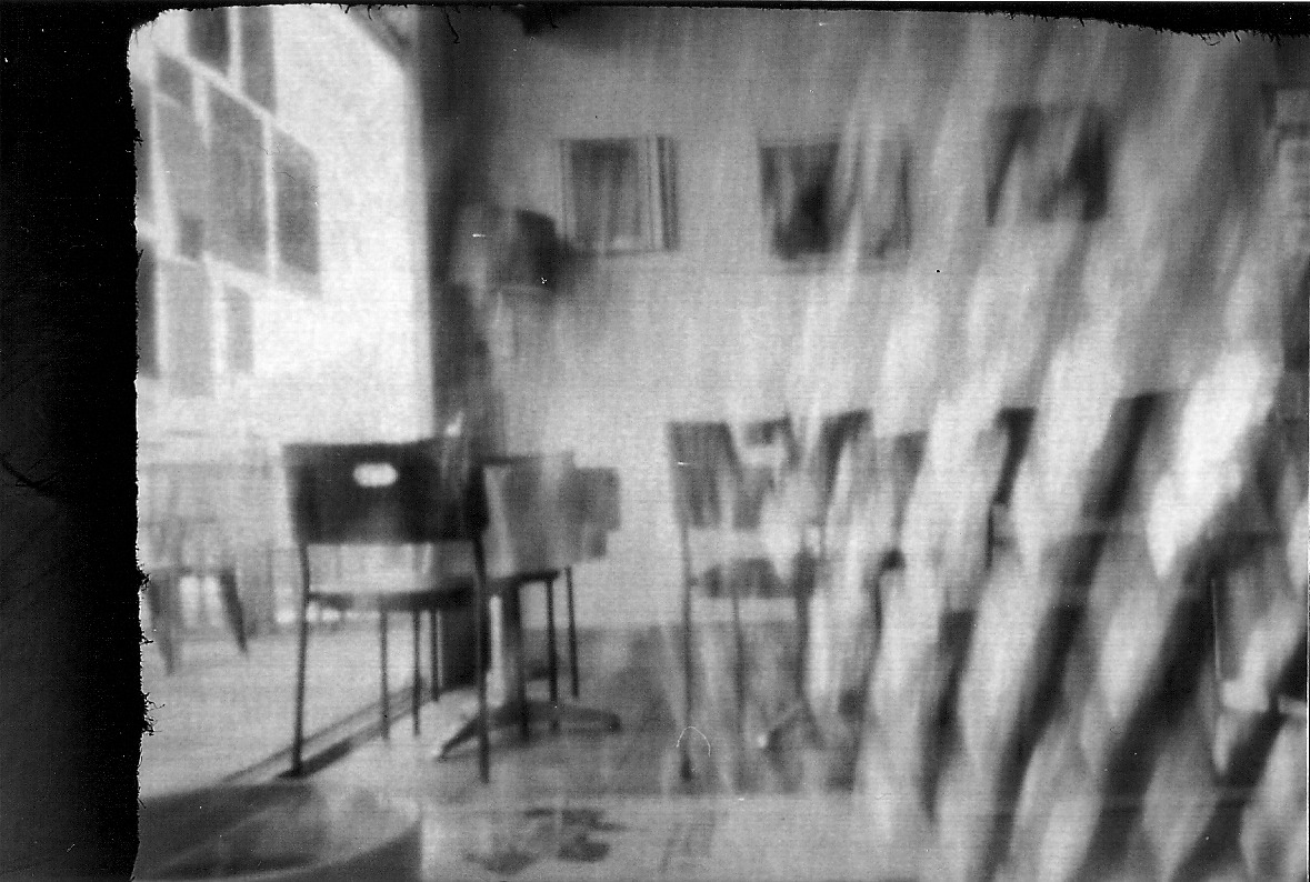 Pinhole double exposure I made a pinhole camera out of cardboard, this is one of the better photos that came from it.  It's a work in progress, I like how it works though and it was super fun to make.