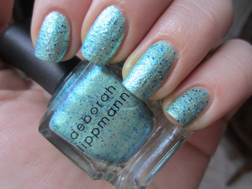 "deborah lippmann ""mermaids dream"" aaammmmaaazzzzing polish! a aqua foil with blue glitter and gold shimmer? for real? and opaque in 2 coats? perfect.  this is going to be my signature summer color.  already worn it 3 times since i bought it."
