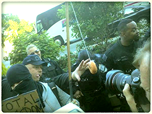 comedychicago:  Occupy Oakland Black Bloc lures Chicago Police Officer with a NATO . monday may 21