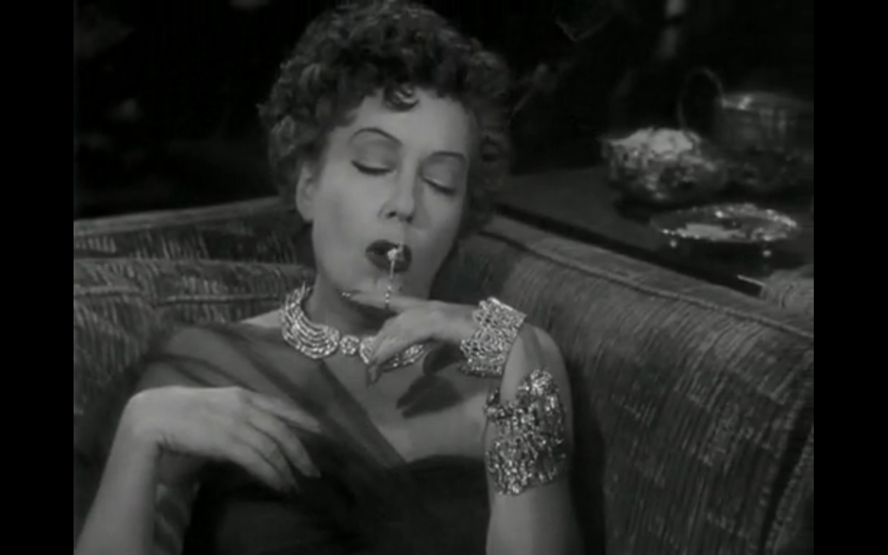 womanhouse:  sunset boulevard, 1950 norma desmond gets wasted and smokes out of a finger attached cigarette holder
