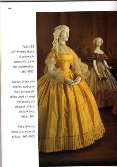 1860s evening dresses.  Both are so stunning! I've been searching for the origin of the dress in the foreground for the longest time, with no luck. I would be infinitely obliged if anyone knows where this dress lies! The dress in the background is housed at the Cincinnati Art Museum: