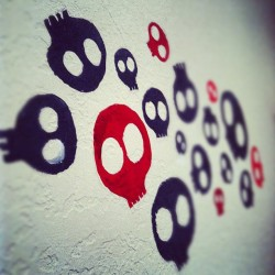 @mrlando4u's paintings he did on his wall. #iphoneography #skulls #black #red #painting #artwork #art (Taken with instagram)