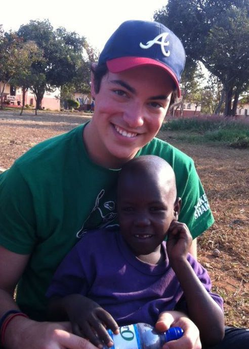 Me and little Chibo at the Tree of Life Orphanage in Zambia, Africa.