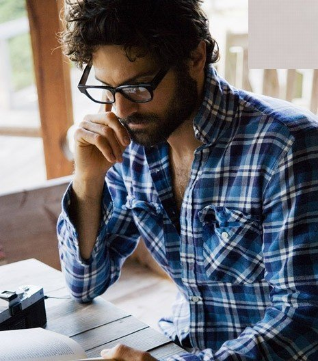 Beard, glasses, plaid, book, camera, morning light… this photo is lovely.