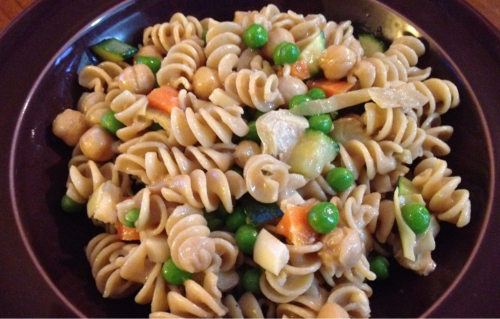 Vegan Pasta Salad So we have been failing on the blog front these days. I am about to graduate from college and E is about to start grad school at Stanford (what a badass). In all this craziness I have eaten way more Trader Joe's Tofu Edemame Nuggets than I am proud of (for strict vegans, these do have egg whites), and haven't managed to get my meals on here.  Anyhow, this is a simple pasta salad, best served cold.  Ingredients: 1/2 bag whole wheat rotini or other noodles 1 large carrot, cut into small chunks 1/2 cup frozen peas 1 zucchini, cut into small chunks Several marinated artichoke hearts, cut into small pieces 2 stalks heart of palm, cut into small chunks 3/4 can chik peas Dressing of choice ( I used tahini dressing, as always, lemon juice, and balsamic vinegar) Directions: Boil water and cook noodles. After straining, rinse with cold water until all noodles are fairly cool, and set aside.  Meanwhile, lightly steam the carrots, zucchini and peas until slightly crunchy In a large bowl, mix cool noodles, all cut up and cooked veggies, chik peas, and dressing, and mix well Eat now or later, it saves well! -N