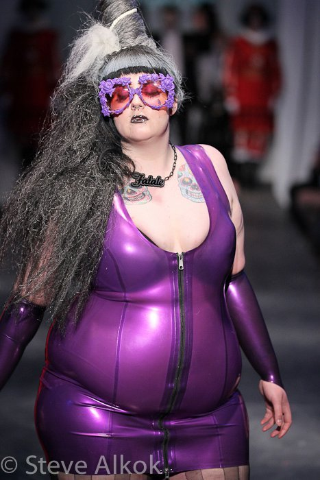 "vile-insect:  untidywhore:  fyeahvbo:  F.A.T. Fashion Show Toronto May 2011  fatspiration.  Everything about this is fucking fabulous, but uhhhh THOSE GLASSES. I NEED THOSE GLASSES.  ""fatale"" yessss [I am suss about the potentially culturally appropriative tatts though)"