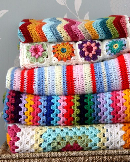 Gorgeous crocheted colourful afghans!  Wowzers. Pic found via Sandra's Cherry Heart — a lovely blog you should visit when you get a chance.