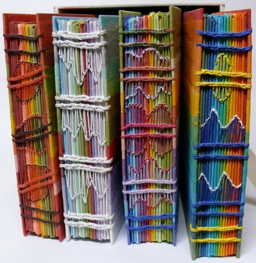 Rainbow Journals (with a page for each day of the year) by Gail Stiffe Handmade, hand-dyed paper. Four books in a box, one book for each season. Hand bound with innovative stitching. View more here.