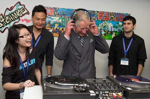 Prince Charles having a giggle on the decks. Photograph: Anwar Hussein/Wireimage More news in pictures