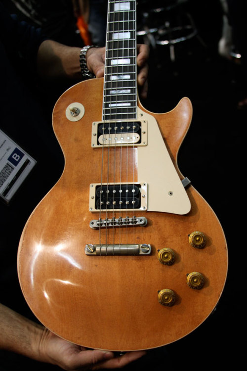 Gibson CS Marc Bolan Les Paul 2011-2012Maple, Mahogany, Ebony Marc Bolan's Les Paul was a FrankenPaul. It was built out of several LPs from different eras. Its whereabouts are unknown, but Gibson believed its last state to be a 50s Les Paul body with a 70s LP Custom neck. That's on these specs that they built the Custom Shop Marc Bolan signature Les Paul. Of course, its a limited run of 100, on top of which another 350 VOS have been produced. The aged finish may be called 'Bolan Chablis', its not by licking the maple top that you'll get a proper taste out of this axe. Photo by the Music Zoo