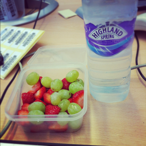 carlzinwonderland:  healthy afternoon snack whilst I'm at work…15 grapes and 10 strawberries… looks like I have loads though doesn't it?! Yay for fruit and healthy things :)  yum!
