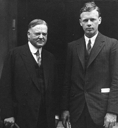 "ourpresidents:  Charles Lindbergh captured the world's imagination when he flew non-stop across the Atlantic Ocean by himself.  Others had flown the distance as teams, but ""Lucky Lindy"" was the first pilot to do it alone.  It took him 33 1/2 hours, between May 20-21, 1927.  Lindbergh was greeted with a hero's return when he traveled back to the United States.  In Washington D.C., President Coolidge welcomed his ship through the Chesapeake and the Potomac rivers with a grand entourage of warships and aircraft.  At the time, Herbert Hoover was the U.S. Secretary of Commerce.  This photo shows Hoover meeting Lindbergh in Washington D.C. after the trans-Atlantic flight. -from the Hoover Library  Less than a century ago, it was a feat to fly across the Atlantic Ocean non-stop. Science!"