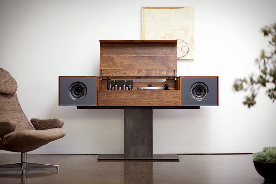 Symbol Record Console  The Symbol Record Console is a bench-made modern record player that pays homage to the all-in-one console hi-fis of the '50s, but bests them with an incredibly clean, modern look. Features include solid American Walnut construction, a metal base, two 6.5-inch full-range speakers, a second, hidden amplifier and subwoofer, built-in Wi-Fi for streaming music from an iPhone, iPad, iPod, or computer, and a hand-built tube amplifier and turntable