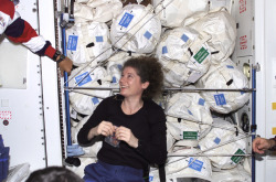 fuckyeahfemaleastronauts:  Susan Helms in front of water bags stored in the Unity module.