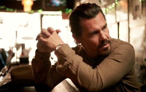 But that Josh Brolin—face unbeaten by Santa Ana winds, limbs not yet thickened with age, voice pinched and overall just a little silly—is not the Josh Brolin of today. The Josh Brolin who walks into The Monkey Bar in New York City early one April morning seems to have wandered off the back lot of a mythic American past. He lopes with the slightly pigeon-toed, bow-legged gait of a cowboy. His arms, unusually long, pendulum slowly. Even his goatee, so often the facial hair of a clown, does little to besmirch the handsomeness of his face.  Much of this unshakeable cowboy aura is due to Brolin's role as Llewelyn Moss in Joel and Ethan Coen's No Country For Old Men, a role so perfectly fit it uncovered what felt like the real man. Much of this is due to Brolin's not inconsiderable skill as an actor. Much of it is determined by our own need for an American hero who wears denim, not Spandex, and who hides his face not behind a mask but under the shadow cast by the brim of a Stetson. But how much of it is true? Josh Brolin Brings the Cinematic Return of the American Man
