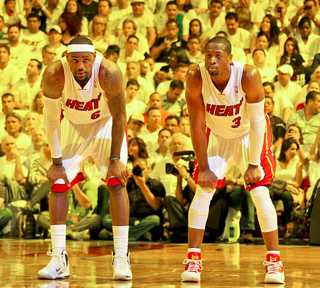 Dwyane Wade and LeBron James catch a quick rest during Game 5 of the Eastern Conference Semifinals on Wednesday. The duo combined for 58 points as Miami cruised to a 115-83 victory. The Heat hold a 3-2 series lead. (Nathaniel S. Butler/NBAE via Getty Images) LOWE: Swarming defense is key in Heat's Game 5 winGALLERY: Rare Photos of Dwyane Wade | LeBron James