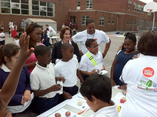 Councilmember Cheh with students at Maury Elementary School in Ward 6 at DC Farm to School Network's annual Strawberries and Salad Greens Day kick off event. The Councilmember wrote the Healthy Schools Act of 2010, a national model for, among other things, bringing more fresh produce into school meals.