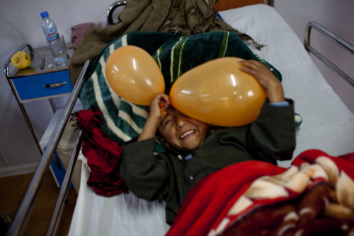 doctorswithoutborders:  Munir*, 8, who broke his leg in a fall, plays in his hospital bed.More photos: Trauma Care Where There Was None in Northern Afghanistan *All patients' names have been changed.Photos: Afghanistan 2012 © Michael Goldfarb/MSF     There can be joy in pain