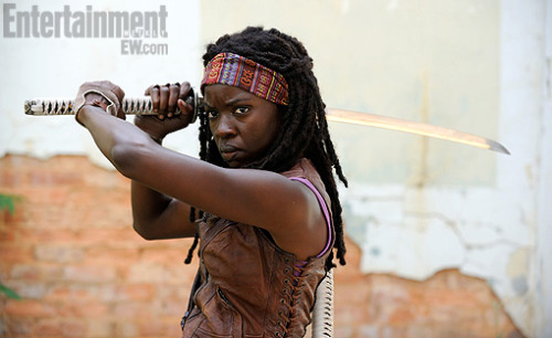 danhacker:  Exclusive first look at Danai Gurira as Michonne In AMC's 'The Walking Dead' EW has the exclusive first look at actress Danai Gurira as Michonne in the third season of AMC's 'The Walking Dead'. I gotta say, looks like they nailed it. Michonne is the Wolverine character of 'The Walking Dead'. I'm curious to see how TV audiences react to one of the more comic book-like characters of 'The Walking Dead', since the show (besides the zombie element) is pretty grounded in reality.   I JUST GOT GOOSEBUMPS ALL OVER
